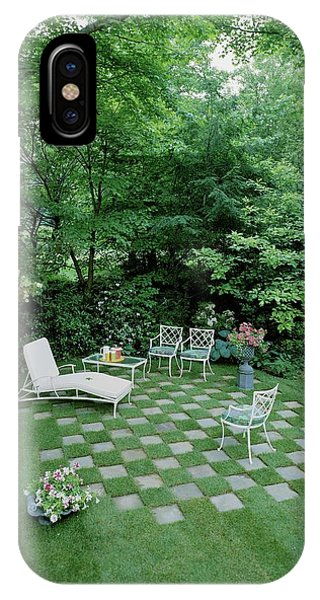 A Garden With Checkered Pavement IPhone Case