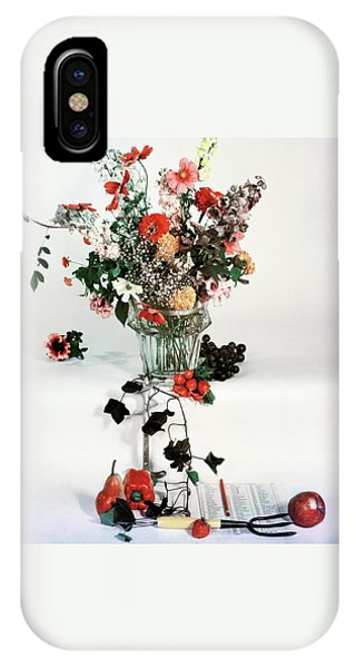 A Studio Shot Of A Vase Of Flowers And A Garden IPhone Case