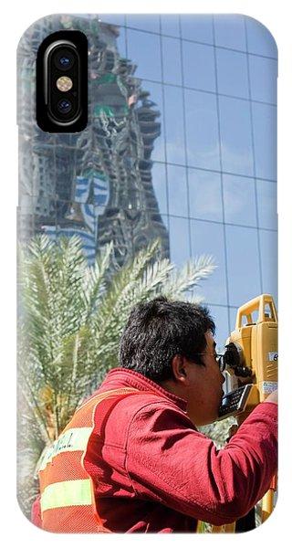 A Surveyor On A Construction Project IPhone Case