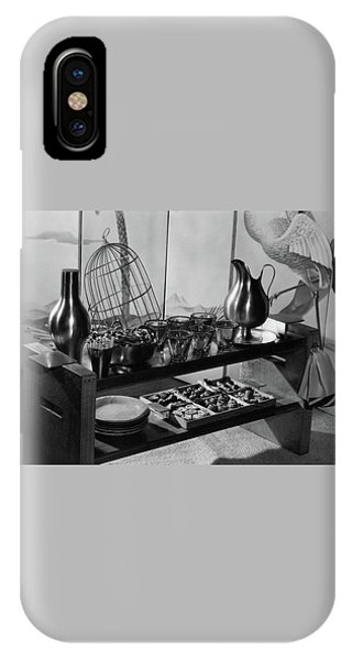 A Table With Tableware And Snacks IPhone Case
