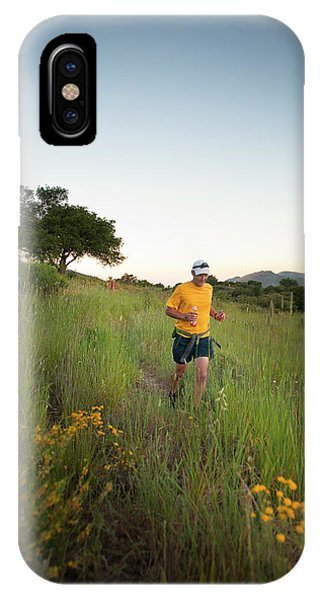 Barbara Steele iPhone Case - A Trail Runner Passes Wildflowers by Kevin Steele