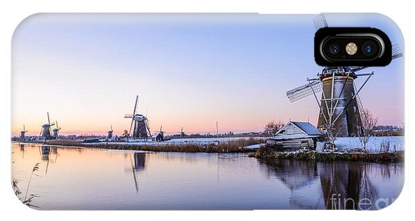 IPhone Case featuring the photograph A Cold Winter Morning With Some Windmills In The Netherlands by IPics Photography