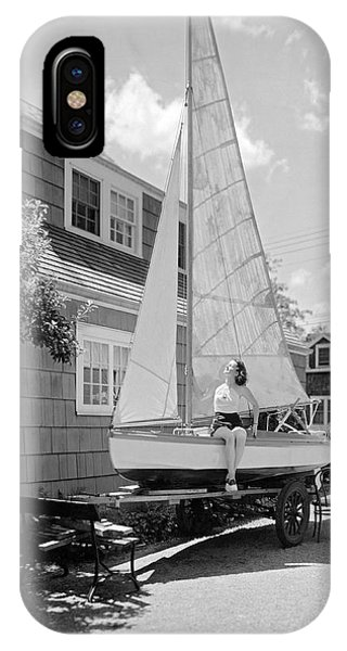 Sunbather iPhone Case - A Woman On Sailboat At Home by Underwood Archives