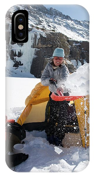 Sangre De Cristo iPhone Case - A Woman Shovelling Snow Away by Kennan Harvey