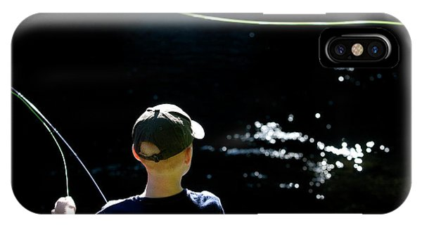 Kingsville iPhone Case - A Young Boy Fly Fishes At Gunpowder by Dennis Drenner