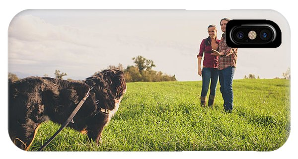 Bernese Mountain Dog iPhone Case - A Young Couple Instruct Their Bernese by Christopher Kimmel