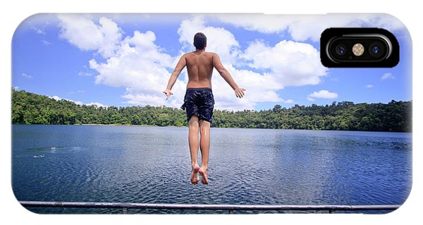 Far North Queensland iPhone Case - A Young Man Jumps Into The Refreshing by Paul Dymond