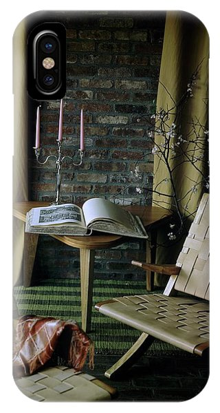 An Armchair Beside A Table And An Old Book IPhone Case