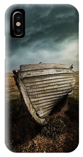 An Old Wreck On The Field. Dramatic Sky In The Background IPhone Case