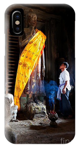 Angkor Wat Devotee Lights Incense In Buddha Temple IPhone Case