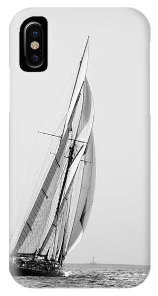 A Tall Ship In Mediterranean Water Approaching To Lighthouse Of Isla Del Aire - Menorca IPhone Case