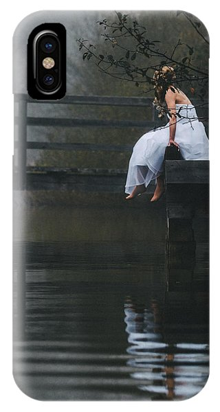 Barefoot Bride In White Wedding Dress Sitting On A Jetty At A La Phone Case by Leander Nardin