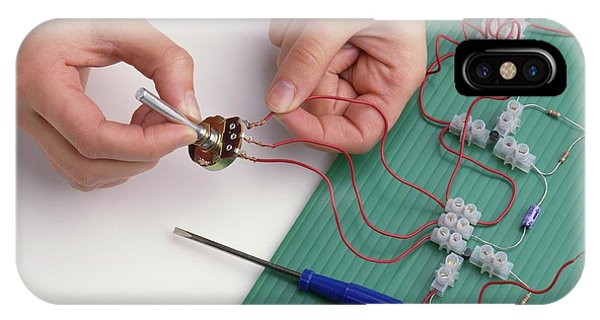 Electrical Component iPhone Case - Boy's Hands Attaching Wires by Dorling Kindersley/uig