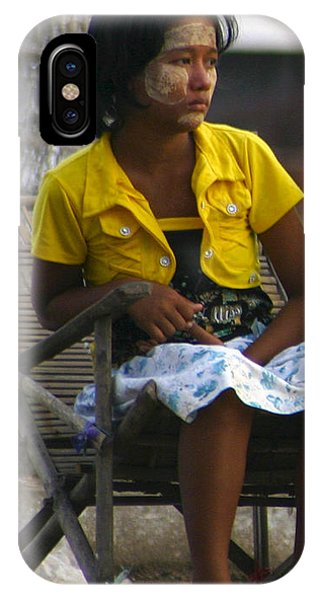 Burmese Girl With Traditional Thanaka Face Painting Sitting On Chair Yangon Myanmar IPhone Case