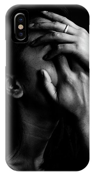 Close-up Of Depressed Woman Against IPhone Case