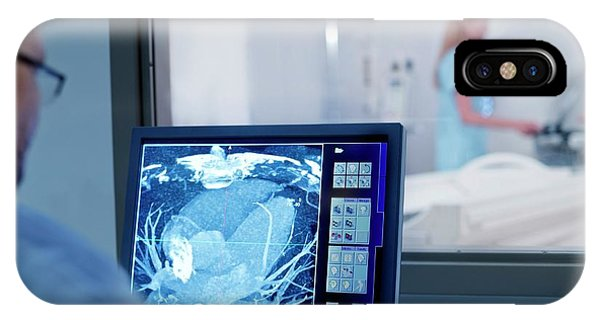 Doctor Looking At Mri Scan On Monitor Phone Case by Science Photo Library