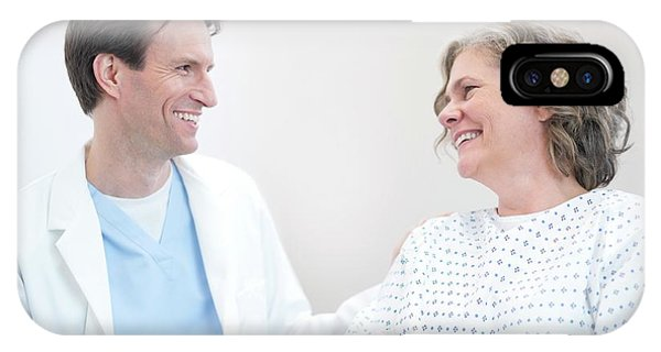 Doctor Smiling At Woman Patient Phone Case by Science Photo Library