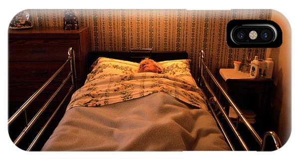Assisted Living iPhone Case - Elderly Woman Lying In A Hospital Bed by Ron Koeberer