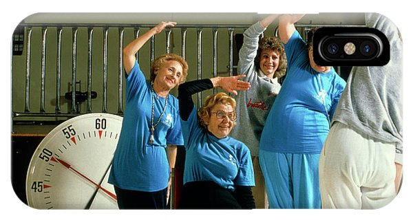 Well Being iPhone Case - Elderly Women Attend An Aerobics Exercise Class by Ed Young/science Photo Library