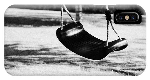 Empty Plastic Swing Swinging In A Garden In The Evening Phone Case by Joe Fox