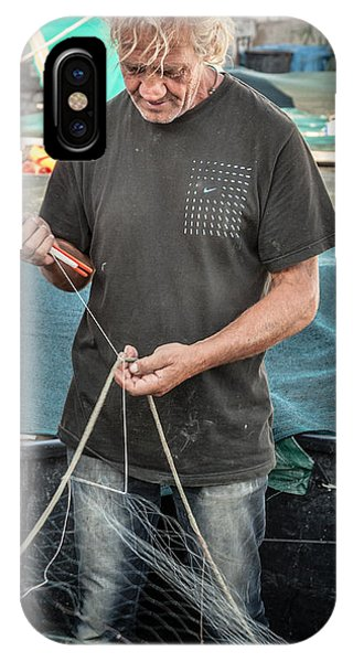 fisherman mending nets on Anzio harbour IPhone Case