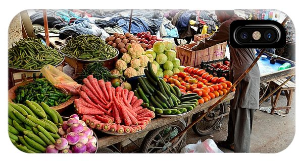 Fruit And Vegetable Seller Tends To His Cart Outside Empress Market Karachi Pakistan IPhone Case