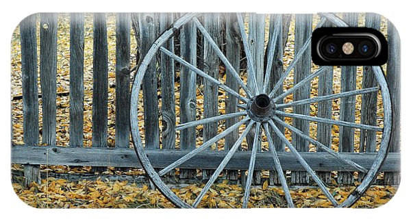 Golden Leaves And Old Wagon Wheel Against A Fence IPhone Case