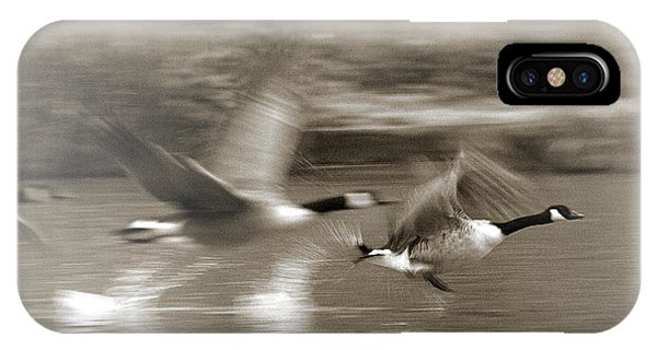 IPhone Case featuring the photograph In A Blur Of Feathers by Jeremy Hayden