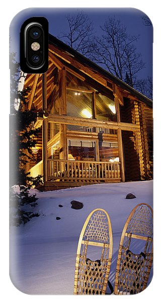 Lighted Cabin With Snowshoes In Front IPhone Case