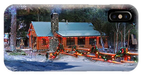 IPhone Case featuring the photograph Log Home On Mount Charleston With Christmas Decoration by Gunter Nezhoda