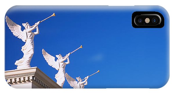 Low Angle View Of Statues On A Wall IPhone Case