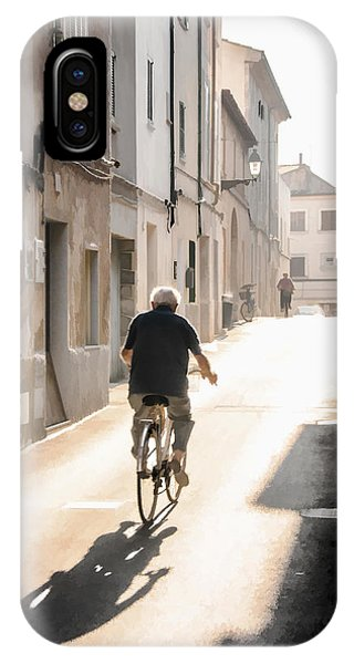 Man Riding Bicycle In Street In Puerto Pollenca IPhone Case
