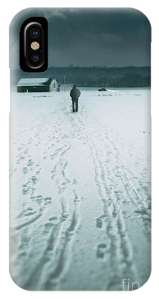 Man Walking In The Distance Towards A Barn IPhone Case