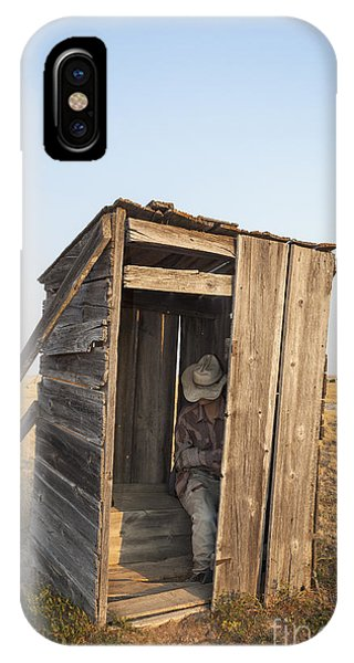IPhone Case featuring the photograph Mannequin Sitting In Old Wooden Outhouse by Bryan Mullennix