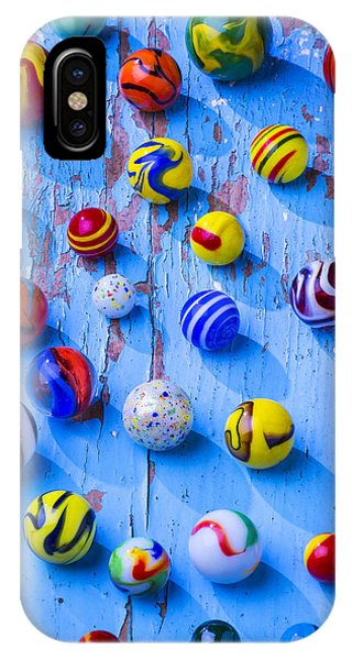 Novelty iPhone Case - Marbles On Blue Board by Garry Gay