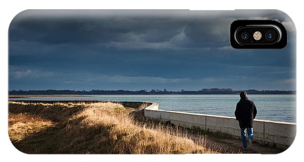 One Man Walking Alone By Sea Wall In Sunshine On Dramatic Stormy IPhone Case