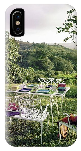 Outdoor Furniture By Lloyd On Grassy Hillside IPhone Case