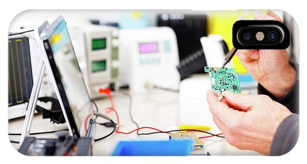 Person Repairing Electronic Circuit Board IPhone Case