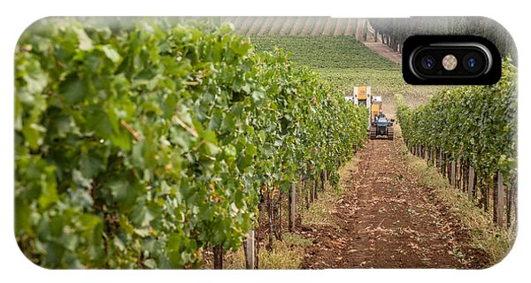 Rows On Vines With A Mechanical Harvester In The Distance Harves IPhone Case