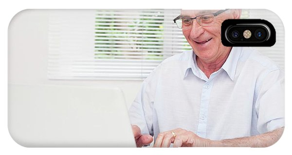 Technological iPhone Case - Senior Man Using Laptop by Science Photo Library