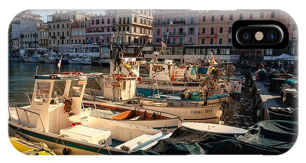 small working fishing boats moored stern first in Anzio harbour IPhone Case