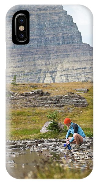 Knit Hat iPhone Case - Solo Female Camper Filtering Water by Heath Korvola