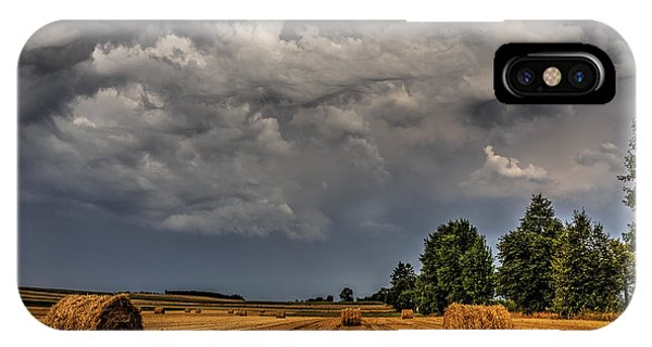 Storm Clouds Over Harvested Field In Poland 2 IPhone Case