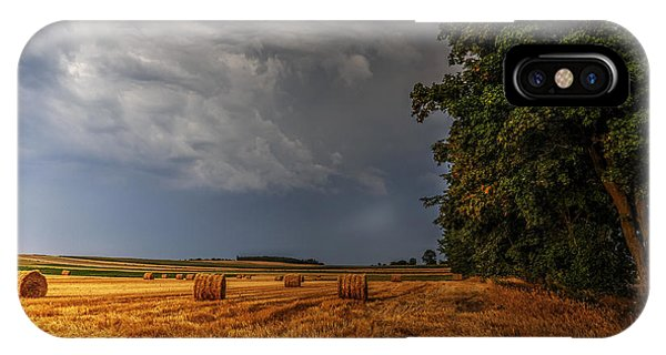 Storm Clouds Over Harvested Field In Poland IPhone Case