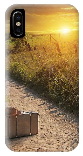 Suitcase With Hat On Road At Sunset IPhone Case