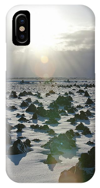 Sun Shining On A Field Of Lava Rocks IPhone Case