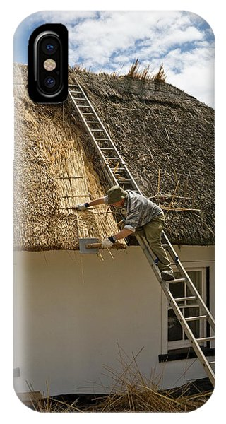 Dunmore East iPhone Case - Thatching A Cottage,dunmore East by Panoramic Images
