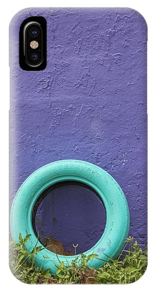 IPhone Case featuring the photograph Tire Painted In Bright Color Leaning Against Wall In San Juan Pue by Bryan Mullennix