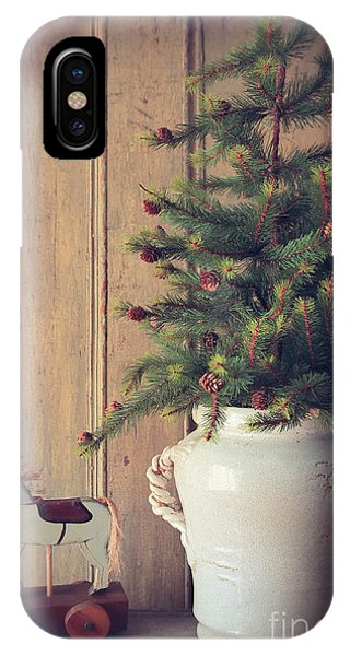 Toy Horse With Christmas Tree On Table IPhone Case