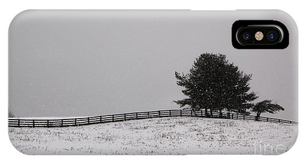 Tree And Fence In Snow Storm IPhone Case